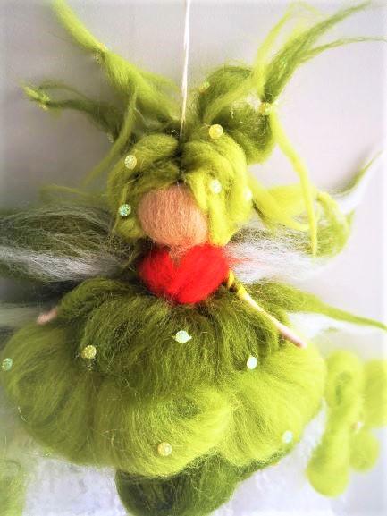 Muñeca de lana peinada